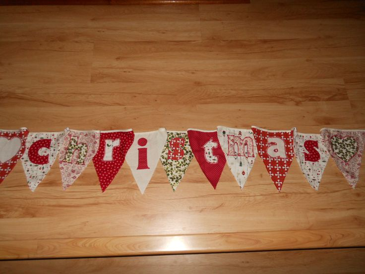 "Bunting with the word ""Christmas"" appliqued upon it."