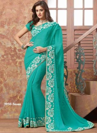 Lovely Turquoise Patch Border Work Chiffon Satin Designer  Sarees http://www.angelnx.com/Sarees/Bollywood-Sarees#/sort=p.sort_order/order=ASC/limit=32/page=3