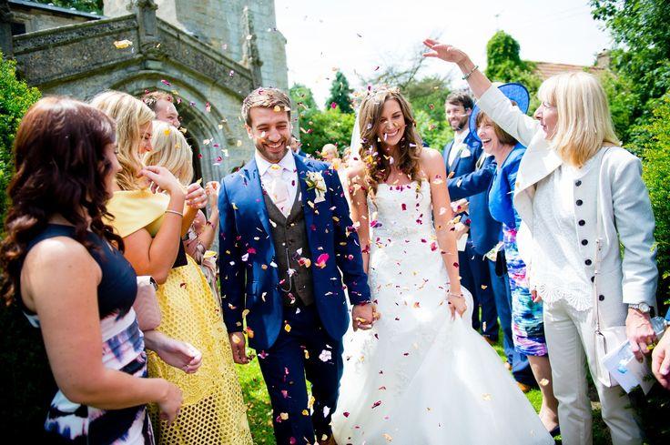 Enzoani Moss Bros Navy suit Ivory  Lace Wedding dress Confetti  Church Wedding