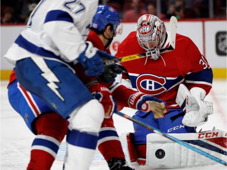 Montreal Canadiens goalie Carey Price makes a save as Montreal Canadiens left wing Max Pacioretty blocks Tampa Bay Lightning left wing Jonathan Drouin from getting to the net during NHL action at the Bell Centre in Montreal on Thursday October 27, 2016.