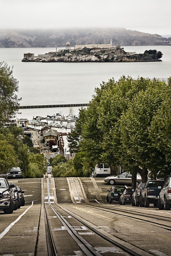 The tracks of the Hyde/Powell cable cars in San Francisco with Alcatraz Island.