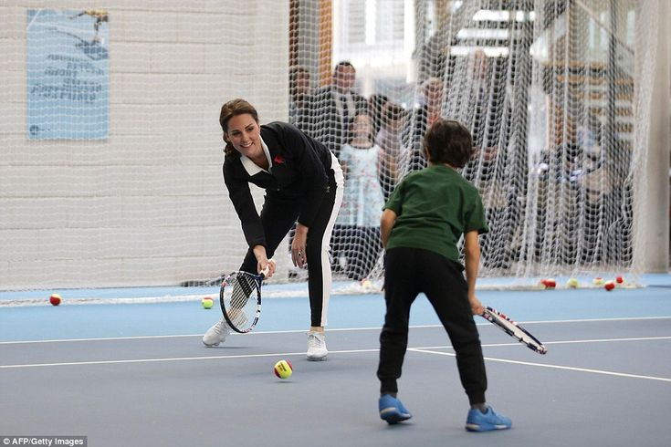 Sporty Kate takes part in a Tennis for Kids session during a visit at the Lawn Tennis Association