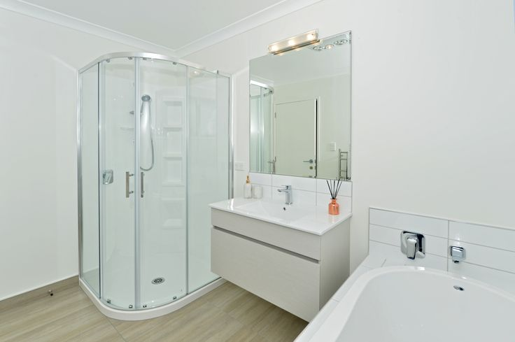 Cezanne Round Moulded Wall shower, Sumner Wall Hung Vanity, and Matisse bath from Clearlite.
