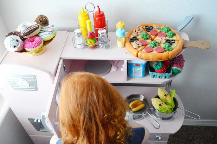 There is just something about a play kitchen, pretend food, and all the necessaryaccessories that I am obsessed with.