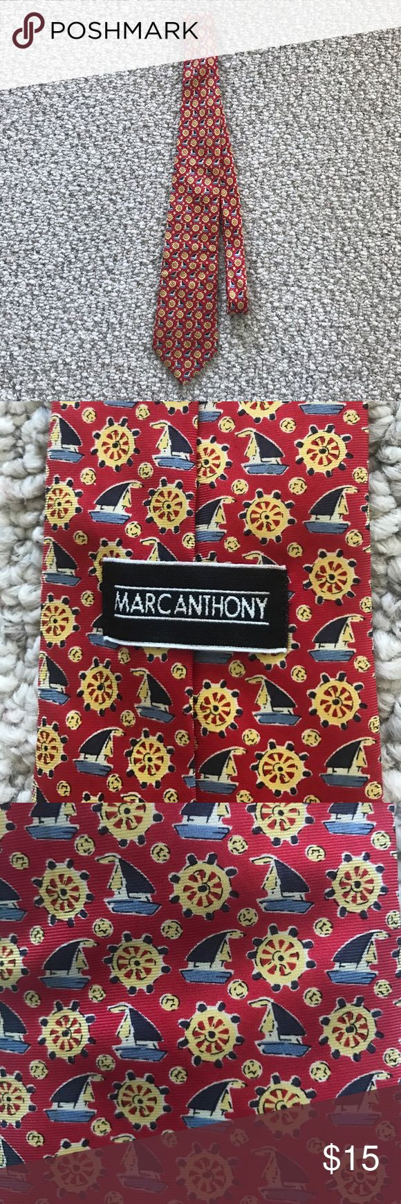 This mens tie is in great shape no marks on it ! 100% sole silk hand made has little boats and boat steering wheels on it. In excellent condition marc anthony Accessories Ties