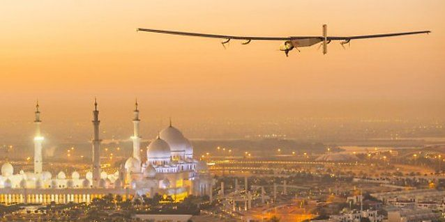 The Solar Impulse 2, a solar-powered plane, flies over the Sheikh Zayed Grand Mosque in Abu Dhabi during preparations for next month's round-the-world flight, February 26, 2015. Swiss pilots Bertrand Piccard and Andre Borschberg will attempt to fly around the world in the Solar Impulse 2, in a bid to prove that such a flight is possible without the use of fossil fuels. The solar-powered plane has a wingspan of 72 metres, larger than that of a Boeing 747, but weighs only 2.3 tons, about as…