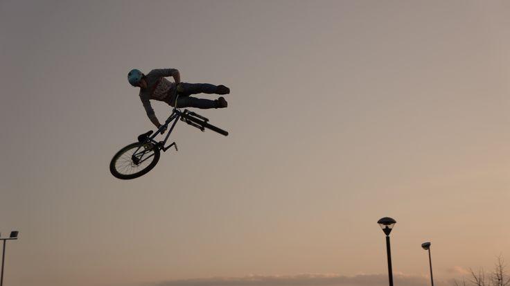 Daniele Raw Ferrri 360 tailwhip in the sunset on his Dartmoor Bikes Quinnie.