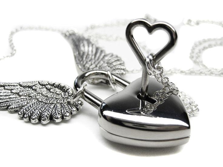Angel Wing Necklace Set. Winged Heart Lock Necklace. Couples Silver Heart Skeleton Key Boyfriend Girlfriend Lovers Padlock Necklace Set. $49.99, via Etsy.