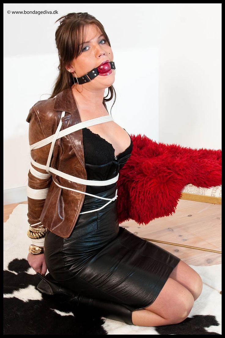 Hogtied in leather skirt