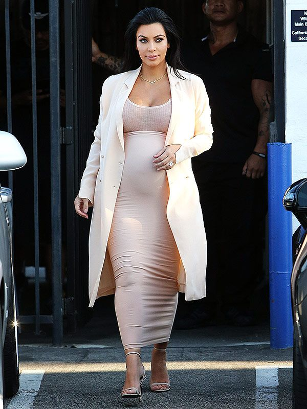 Kim Kardashian Trades Her Maternity Crop Top for a Peachy Ensemble http://celebritybabies.people.com/2015/09/05/kim-kardashian-wears-peach-maternity-outfit/