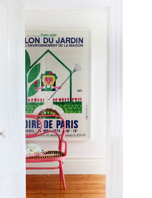 Love this vintage poster and hot pink chair. Heather Nette King via The Design Files.