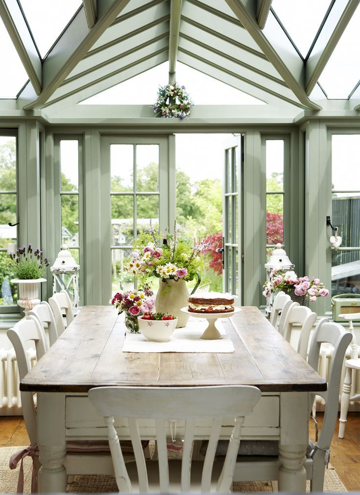 This dining table and chairs complement the green timber conservatory perfectly…