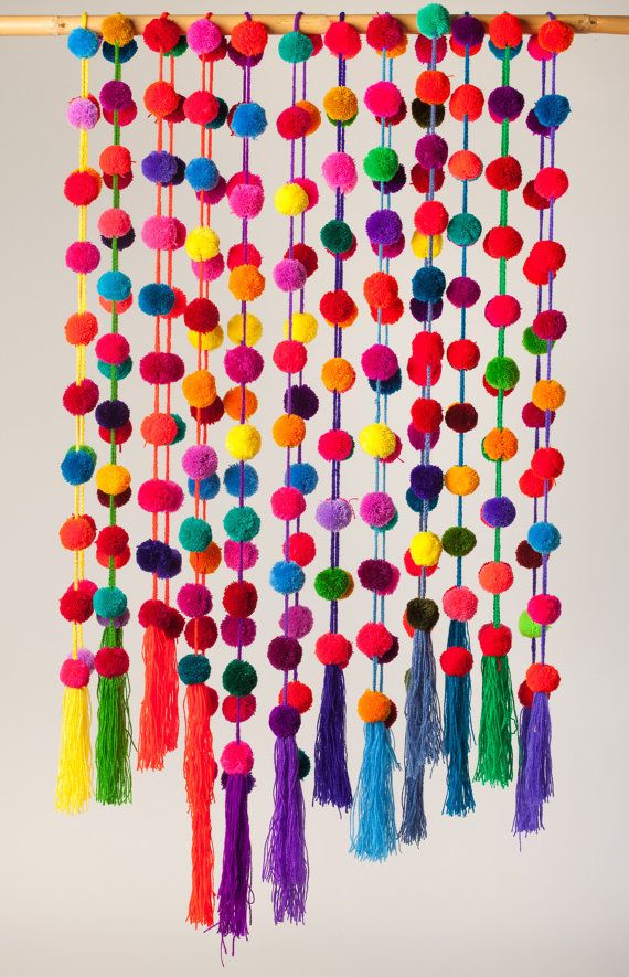 Handmade colorful pompom garlands. Beautiful 150 cm / 59 long, multicolored, handmade pompom garland. These colorful garlands are handmade by Maya-Tsotsil women from Chiapas state, in southern Mexico. Traditionally, women in Chiapas Highland have worn brightly colored pom poms on their hair. Now, they offer their pom poms to us as garlands so we can decorate our world with their colors and beauty. It can be used as a garland, belt, curtain, party decoration or Christmas tree decoration....