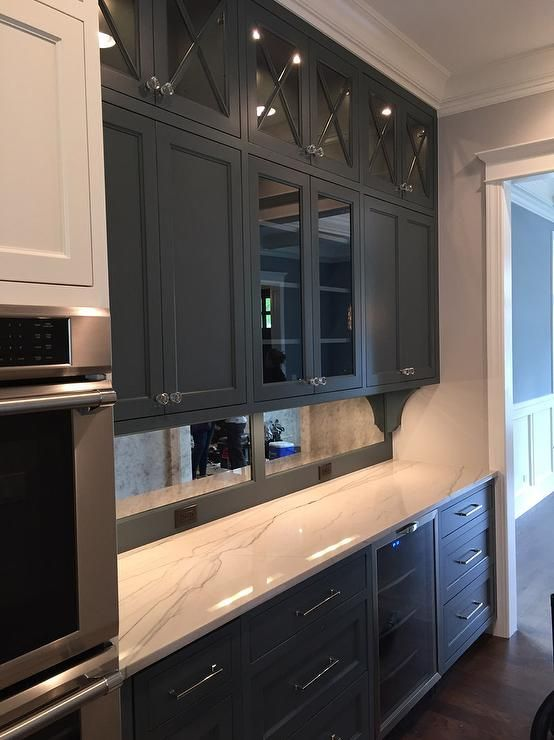 Black and white butlers pantry features black shaker