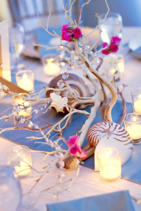 Beach wedding centerpiece. Driftwood, shells, candles, flowers.