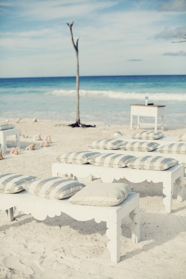 Rustic elegant bench seating on the beach in the Bahamas. Love the striped pillows. Photography by jenellekappe.com, Event Planning, Floral   Event Design by littleislanddesign.com