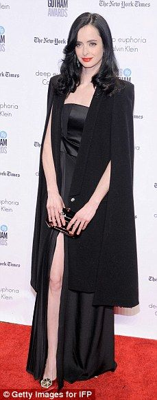 Dark side: The 34-year-old actress wore a black jacket over a matching dress...