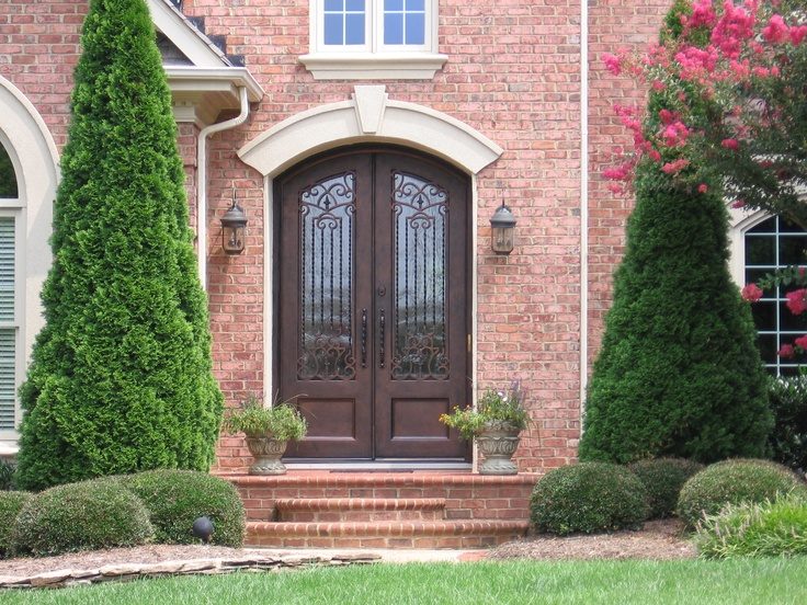 An eyebrow top double wrought iron door in charlotte nc for Exterior doors charlotte nc