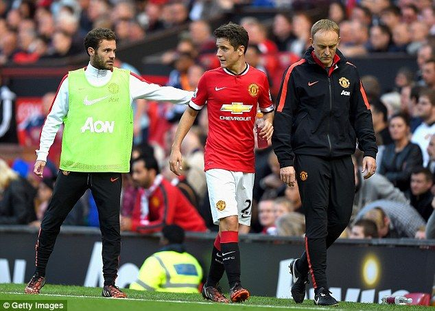 Ander Herrera is consoled by compatriot Juan Mata after being taken off injured in Man United's match with West Ham at the weekend