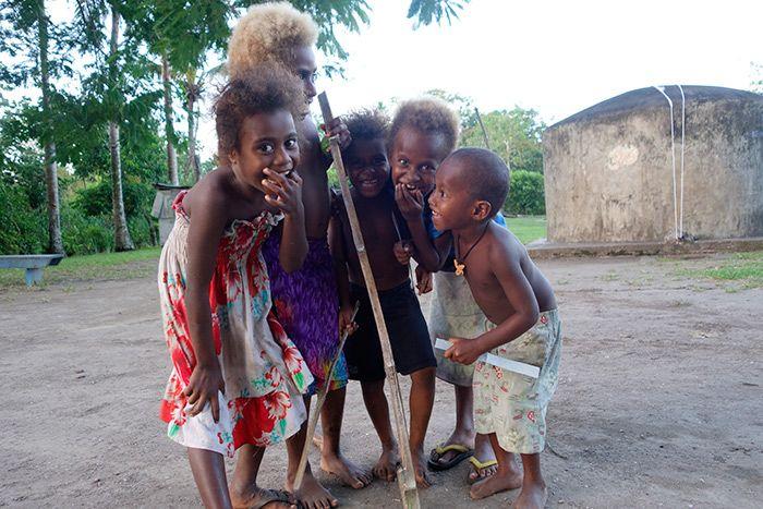 Just kidding around. Photos of children of Waisisi Area, Efate Island.