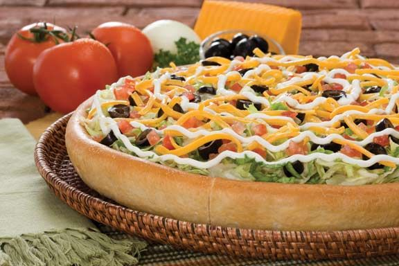 Can't get enough of our spicy Taco Pizza? Then it's time to upgrade. Our Super Taco adds some black olives, sour cream, and even more cheese to create a pizza that's simply delicioso! #pizza #godfatherspizza