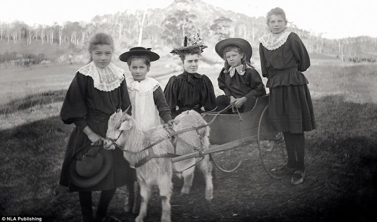 Three members of the Corkhill family with their governess and a friend on the outskirts of...