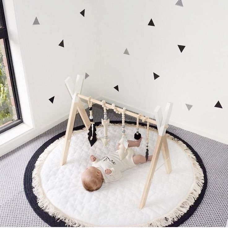 Wooden play gym for baby