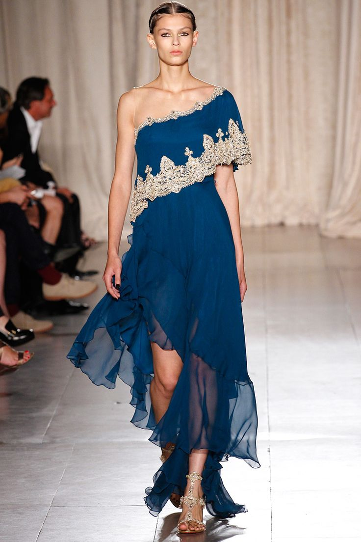 I cannot resist anything in Peacock blue and the shoulder of this dress is devine!  Sherbet hued pastels and electric brights have been having a huge moment on the Spring runways--it is nice to see jewel tones are still finding their way into Spring 2013.  Marchesa