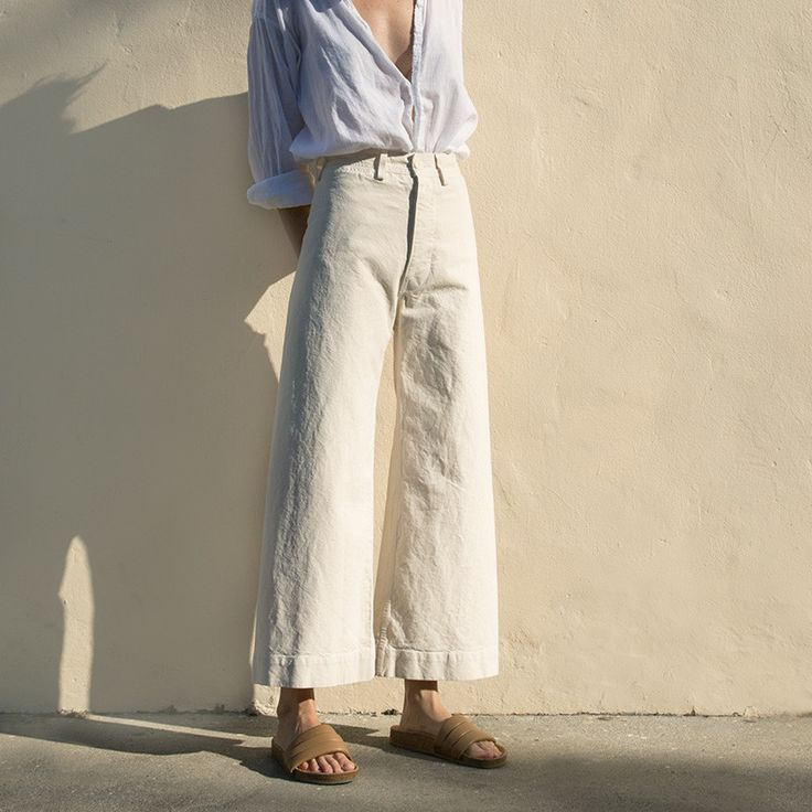 A signature Jesse Kamm silhouette in a new natural color and 100% fine Japanese cotton canvas. These high-waisted pants feature the classic cropped wide leg, hi