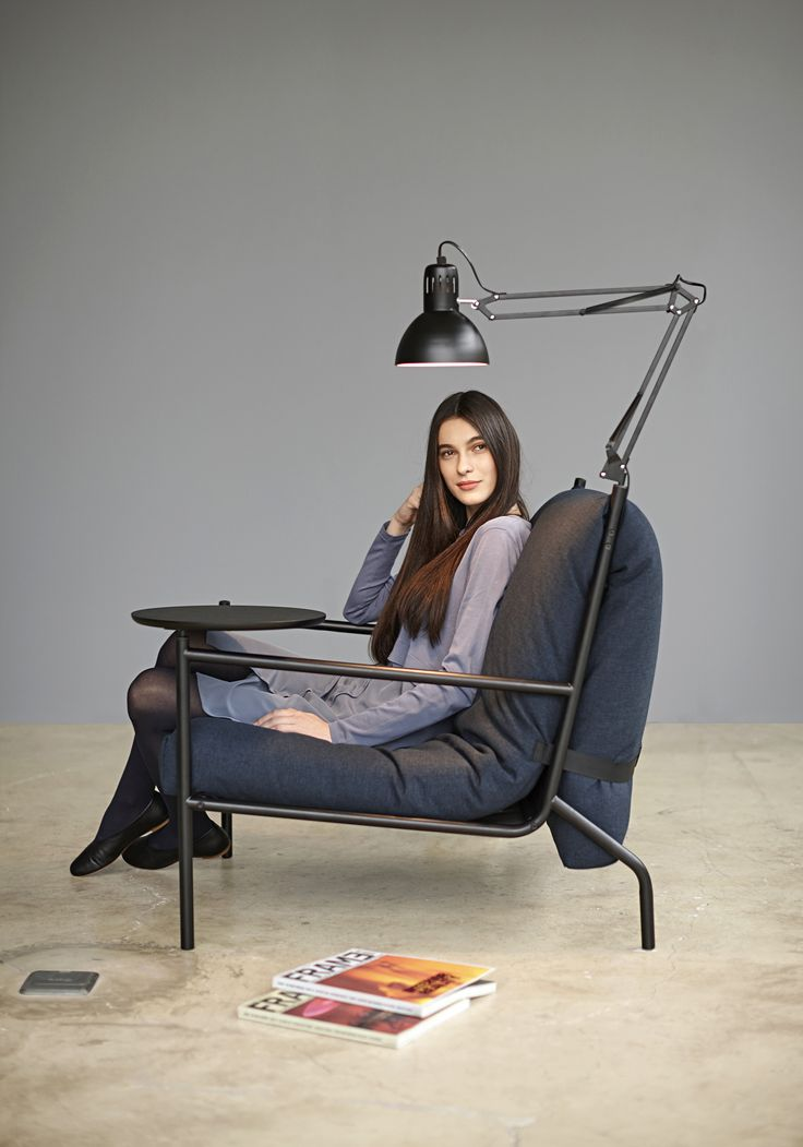 A multifunctional chair with intergrates lamp and swing table