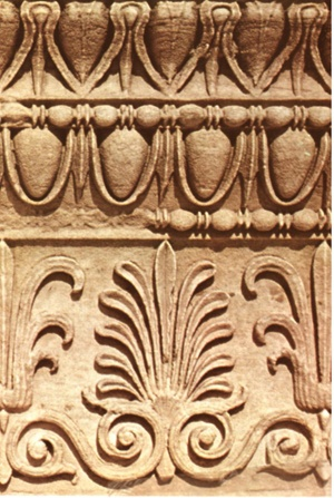Anthemion (A classic Greek decorative motif of alternating lotus and palmette leaves, referred to as anthemion pattern, was commonly used in design of vases and architectural moldings.
