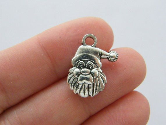 BULK 50 pieces of Father Christmas charms antique silver tone  Free shipping  Each charm is made from a zinc alloy metal which is lead free. Single sided father xmas charm!  Measurements: 12mm × 23mm  Please visit my shop for more items :-) x