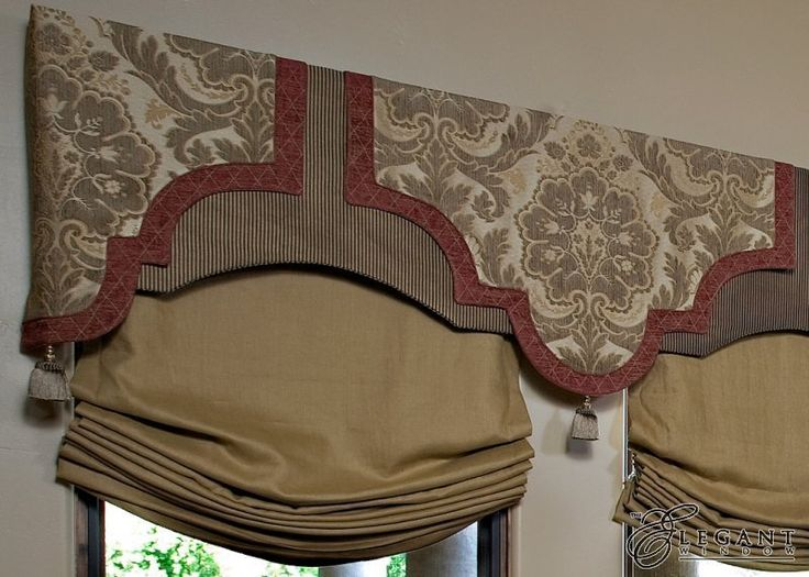 flat shaped valance with banded design, and soft romans below. Different look... I like !!!