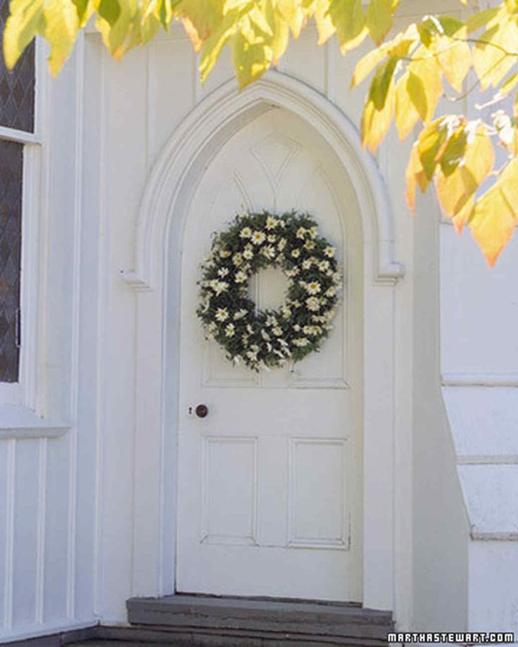 Daisy Welcome Wreath | Martha Stewart Living - Stud a green wreath with unassuming daisies -- the friendlist flower -- for homegrown DIY charm.