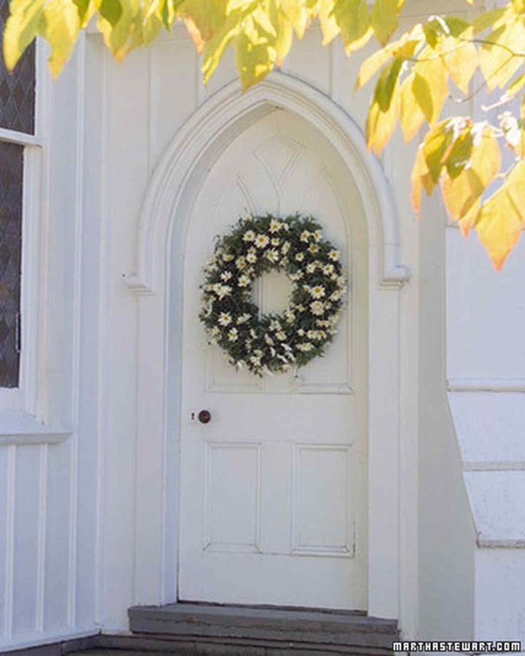 Daisy Welcome Wreath | Martha Stewart Living - Stud a green wreath with unassuming daisies -- the friendlist flower -- for homegrown DIY charm.