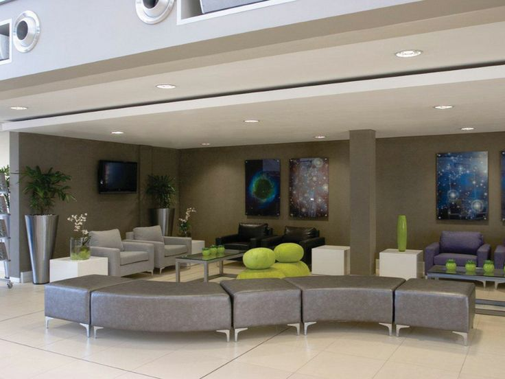 Corporate Interiors, using snake ottomans to create an interesting soft seating area