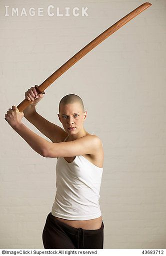 RM 43683712 Young woman posing with a bokken :: ImageClick