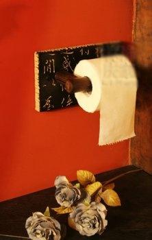 Asian themed bathroom; burnt orange wall color