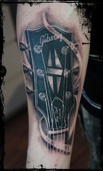 http://artetattoo.com.br/wp-content/uploads/2012/06/Gibson-Guitar-Tattoo.jpg
