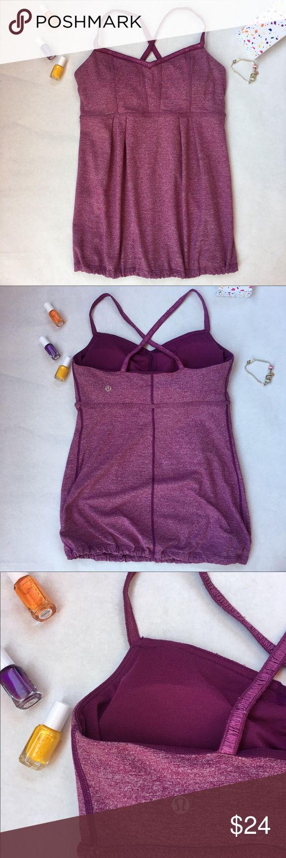 LULULEMON purple tank top 8 Super cute with flattering fit. Crisscross straps and drawstring at hem. Only sign of wear is on the inner portion, where there is some light piling on the inside of the straps and bra. (Can't tell when wearing.) Removable padding in built-in bra. lululemon athletica Tops Tank Tops
