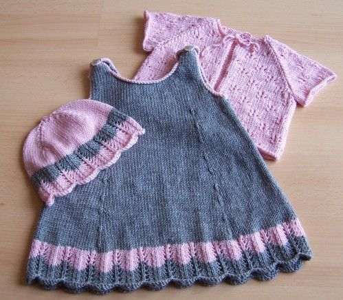 I'm thinking grey and light pink with a scalloped hem and piping down the sides with some cute pockets.