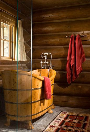 This deep claw footed tub makes me think of a western movie.  The room is simply decorated but inviting.