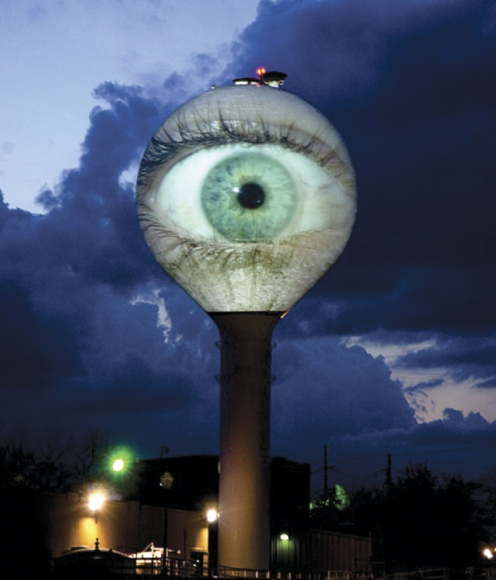 """Eye of Texas,"" 2007, an interactive digital video projection on the 85-  foot tall Green Water Treatment Plant water tower, Austin"