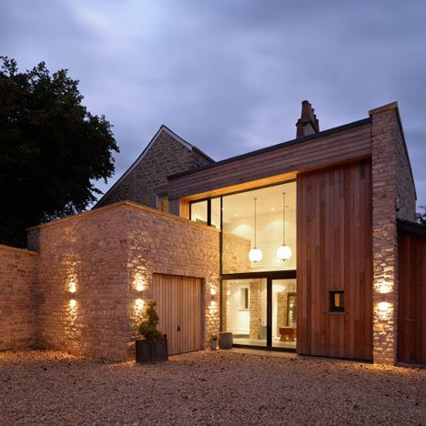 English architects Designscape have reversed the orientation of a country house in Bath by adding a prominent glazed entrance to its rear. Flanked by Bath stone walls, the extension to The Fosse comprises a single-storey garage and the double-height entrance lobby, which overlap one another to create balconies both inside and out. Timber-clad exterior walls …