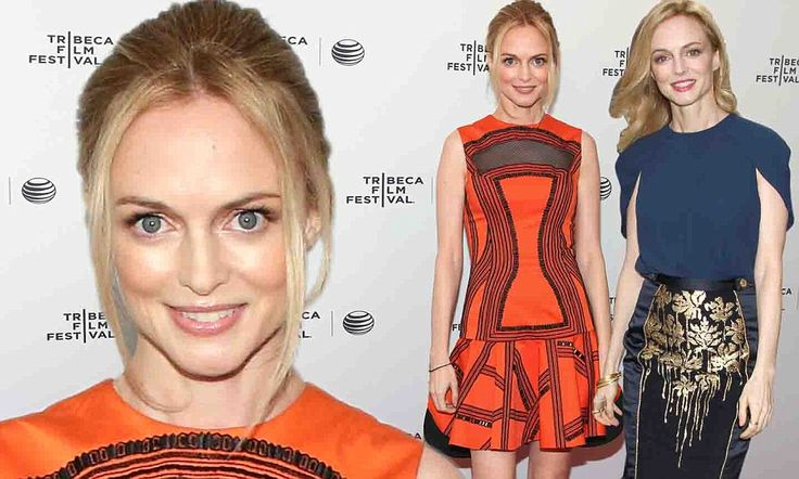 Heather Graham steps out in orange dress and navy blue caped blouse