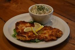Probably the only #Schnitzel offer in #Blount County. We tenderly #tenderize our quality #pork, we handbread it, and we cautiously fry it in a skillet until golden brown. Enjoy it with the fruity #potato salad.