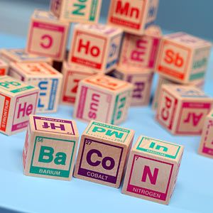 Geek chic! Love it - periodic table building blocks.  My sister has the periodic table as a shower curtain - brilliant.  Just love it!
