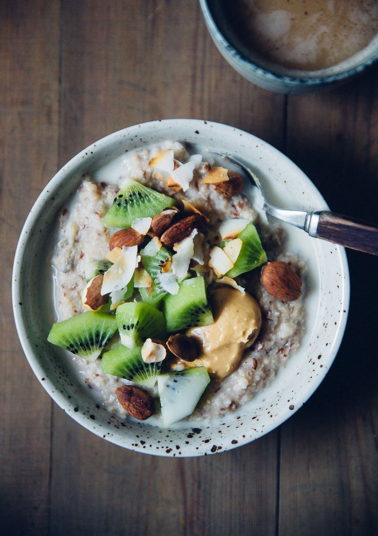 Millet Porridge with kiwi, peanut butter, almonds & toasted coconut - quick to assemble on busy Monday mornings | Cashew Kitchen