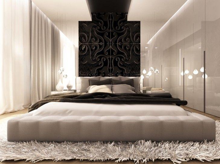 Projekt wnętrza ekskluzywnej sypialni w domu pod Warszawą. Ornamenty na wezgłowiu łóżka dodają elegancji i kontrastują z białym tapicerowaniem.