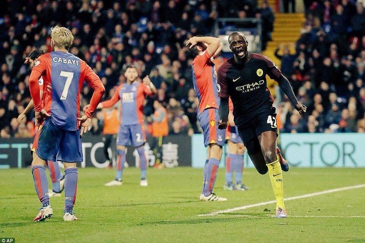 Yaya celebrates one of his two goals against Crystal Palace .